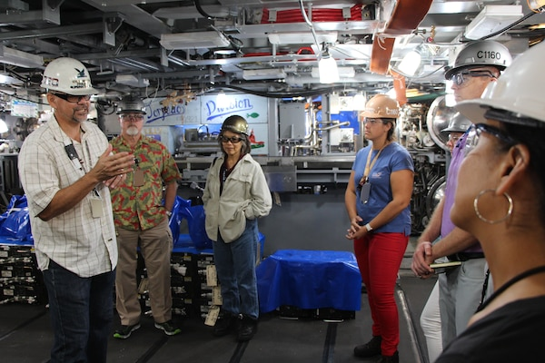 USS Missouri (SSN 780) Project Superintendent Chad Nishida explains to Code 1160 Congressional and Public Affairs Office the importance of getting submarines out on time to help support our nations defense as we face threats from adversaries in the Pacific.