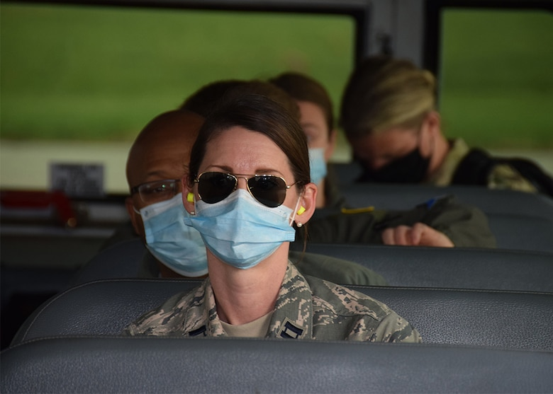 Capt. Sarah Arrellano, 433rd Aeromedical Staging Squadron clinical nurse, one of 10 Reserve Citizen Airmen returning home from New York City, waits on a bus for transportation to lodging May 28, 2020 at Joint Base San Antonio-Lackland, Texas.