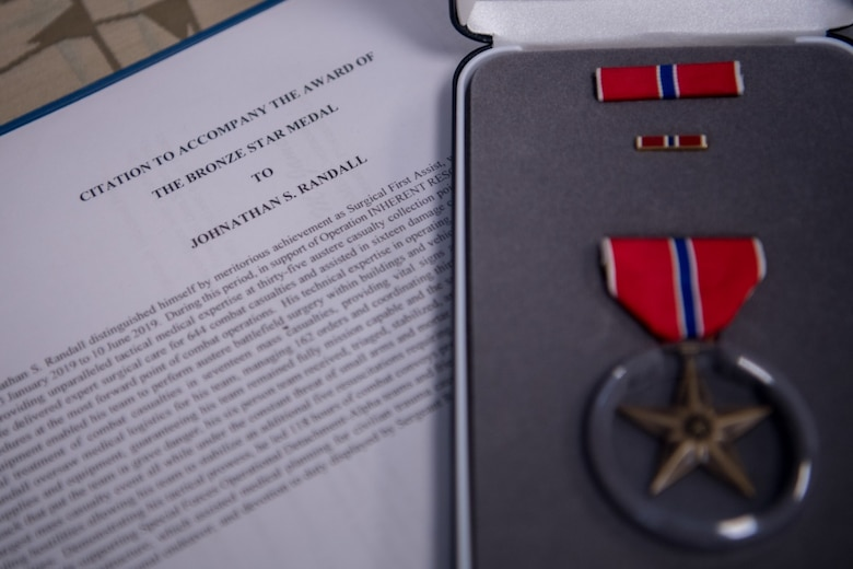 An awards decoration and Bronze Star medal lay on a table