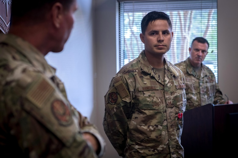An airman, right, looks at his commander ,left, as he gives comments.