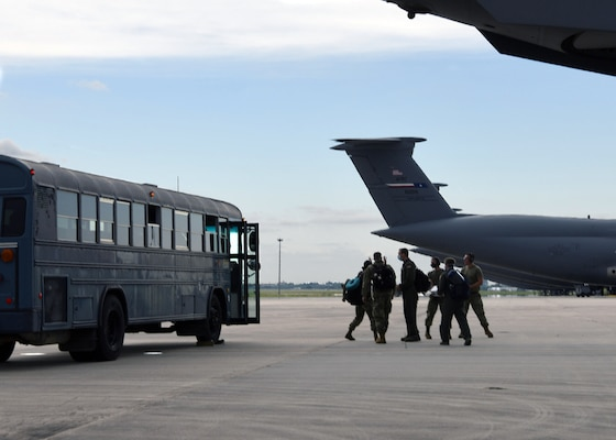 Reserve Citizen Airmen from the 433rd Medical Group celebrate after returning home from a deployment to New York City, May 28, 2020 at Joint Base San Antonio-Lackland, Texas.