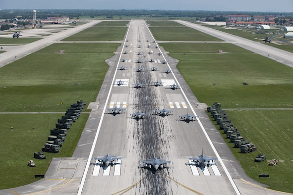 U.S. Air Force aircraft and vehicles assigned to the 31st Fighter Wing line the runway during an elephant walk at Aviano Air Base, Italy, June 1, 2020. Despite the restrictions in place due to COVID-19, the 31st FW remains lethal and combat ready, prepared to deter or defeat any adversary who threatens U.S. or NATO interests. (U.S. Air Force photo by Airman Thomas S. Keisler IV)
