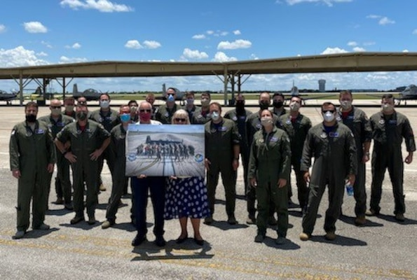 T-6 pilots assigned to the 340th Flying Training Group's 39th Flying Training Squadron and the 12th Flying Training Wing's 559th FTS gathered to honor retiring Joint Base San Antonio-Randolph, Texas T-6 maintainer Carl Powers (pictured here holding his farewell memento with his wife Arlene). Powers retired May 31 after nearly 50 years of uniformed and civilian service. (U.S. Air Force photo)