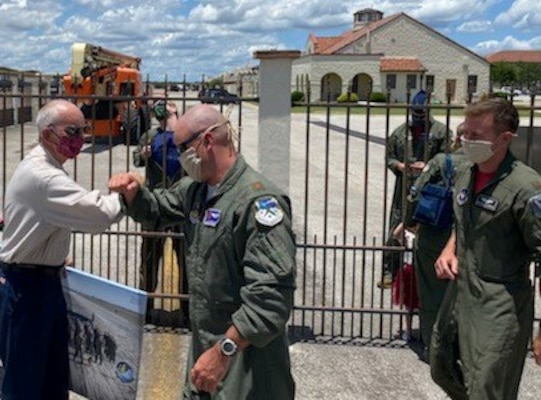 T-6 pilots assigned to the 340th Flying Training Group's 39th Flying Training Squadron and the 12th Flying Training Wing's 559th FTS bump elbows (the pandemic handshake) with retiring Joint Base San Antonio-Randolph, Texas T-6 maintainer Carl Powers, who retired May 31 after nearly 50 years of uniformed and civilian service. (U.S. Air Force photo)