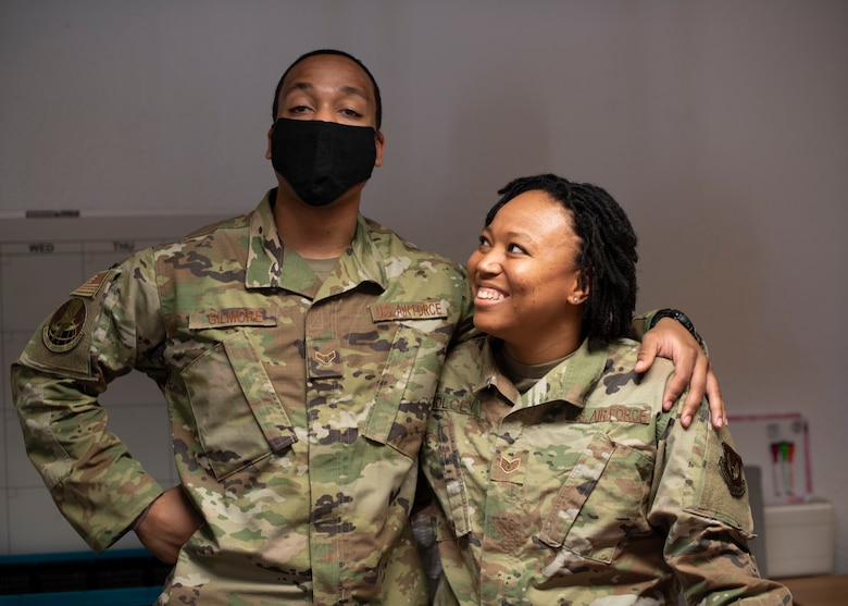 U.S. Air Force Staff Sgt. Jasmine Holcey, right, 786th Force Support Squadron relocations supervisor, poses for a photo with A1C Joshua Gilmore, 786 FSS relocation apprentice, at Ramstein Air Base, Germany, June 1, 2020.