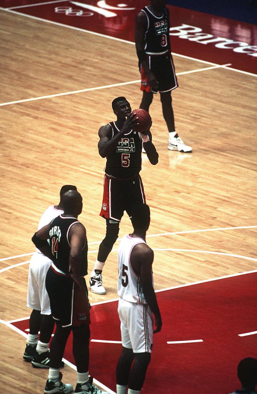 Basketball player prepares to make a free throw.