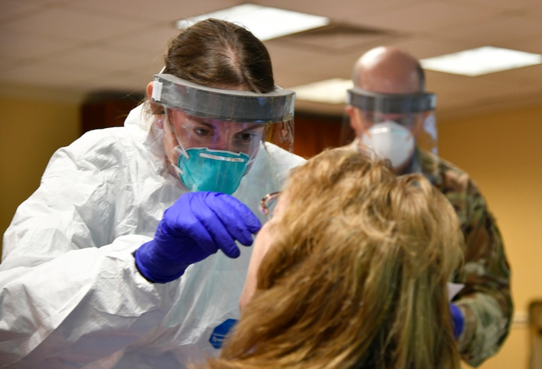 U.S. Air Force Tech. Sgt. Danielle Fary, 110th Medical Group, 110th Attack Wing, Michigan Air National Guard, conducts COVID-19 testing of employees at Riveridge Rehabilitation and Healthcare Center, Niles, Michigan, May 28, 2020. As of May, more than 1,000 Michigan Guard Soldiers and Airmen were actively supporting the state's COVD-19 response.