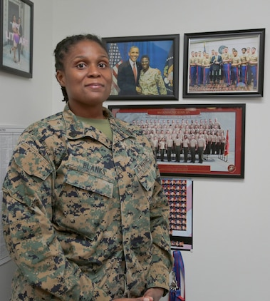 Already having two older brothers in the Marine Corps, Staff Sgt. Latifah Blanks had a legacy to live up to when she joined the Corps in 2011. The St. Louis native, currently serving as base adjutant chief, Marine Corps Logistics Base Albany, went to Marine Corps Recruit Depot Parris Island in South Carolina at the age of 20. It was an opportunity to see the world and gain some discipline, not her siblings, compelling her to become a Marine. (U.S. Marine Corps photo by Jennifer Parks).