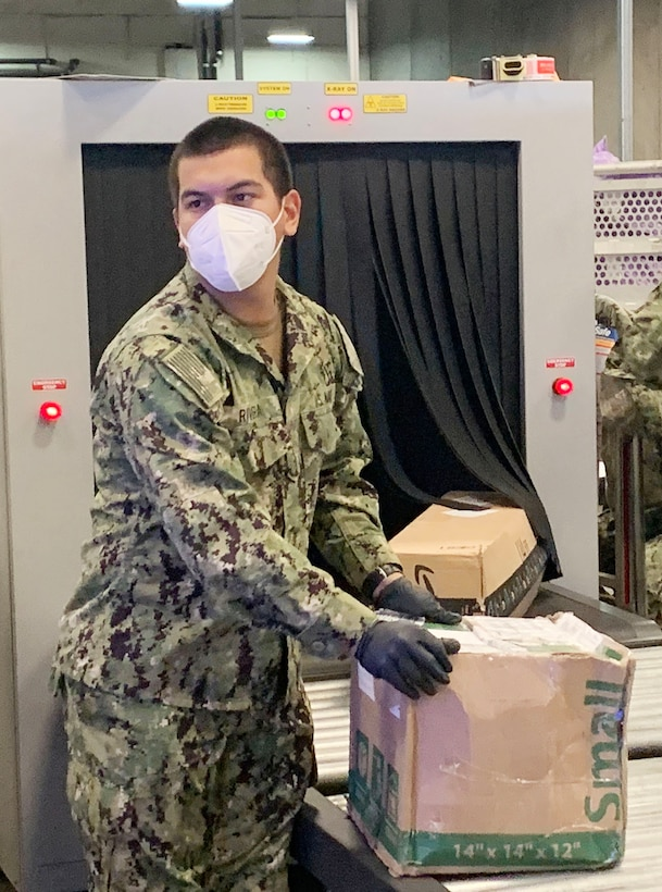 Sailors handling mail at the San Diego Regional Navy Mail Center.