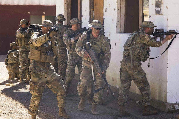 Paratroopers with 2nd Battalion, 10th Special Forces Group (Airborne), practice cordon and search tactics during warfighter training at Fort Carson, Colorado, in 2018. Huntsville Center's Range and Training Land Program prepared programming cost estimates for a shoothouse at the post to support the U.S. Army Special Operations Command's project approval and funding process.