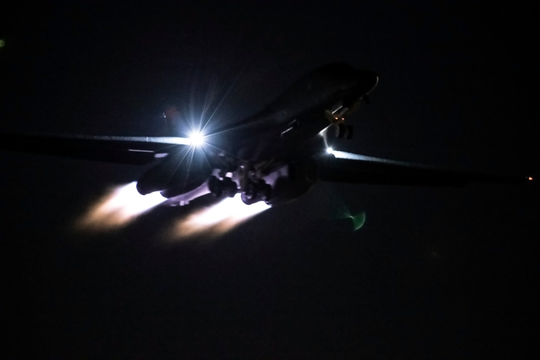 A B-1B Lancer soars through the night sky above Nellis Air Force Base, Nev., during Red Flag 20-1, Jan. 30, 2020. Flight surgeons help to make the mission possible by ensuring that aviators are fit to fly prior to takeoff. (U.S. Air Force photo by Airman 1st Class Christina Bennett)