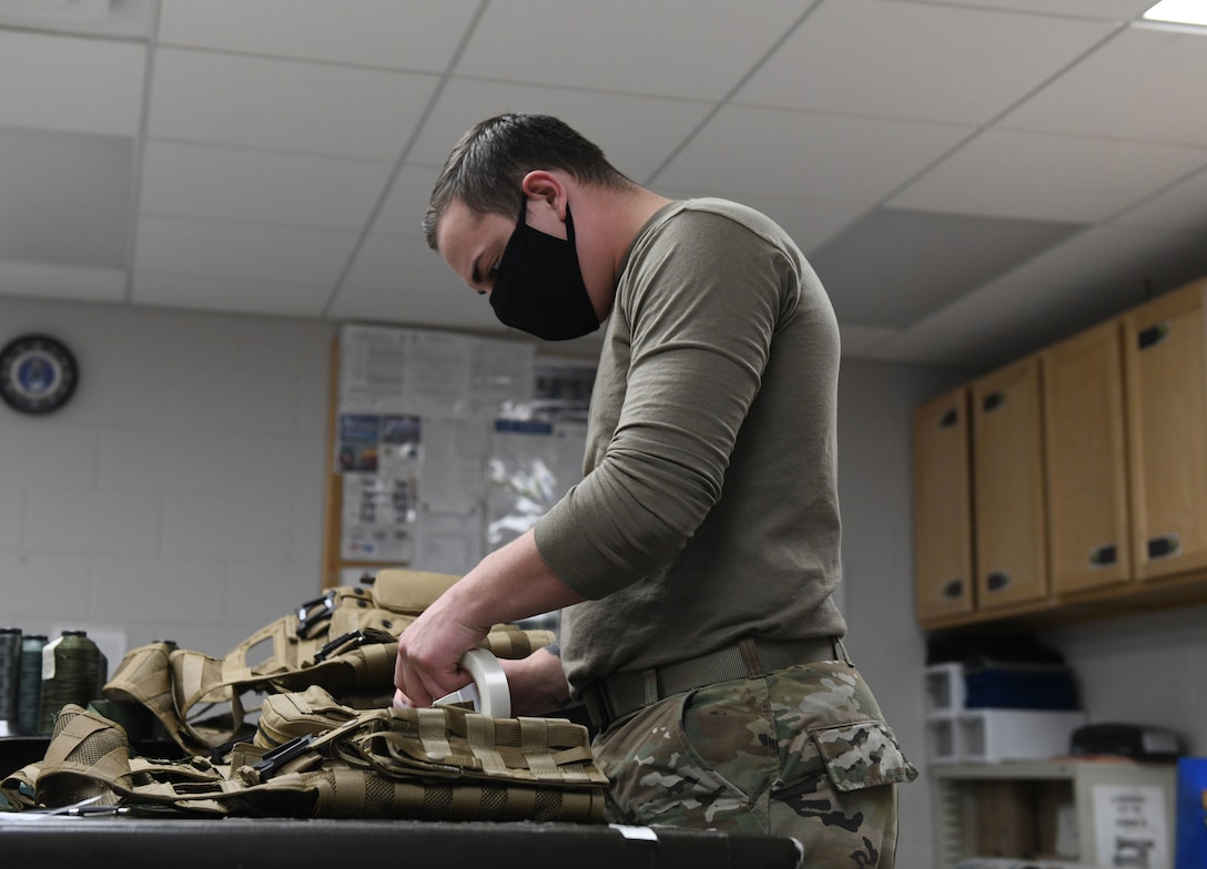 An Airman assigned to the 28th Operations Support Squadron tests equipment for aviators prior to a more than 25-hour non-stop deployment from Ellsworth Air Force Base, S.D., to the U.S. European Command area of responsibility May 4, 2020. In addition to caring for aviators, many flight surgeons serve as occupational medical specialists by monitoring the safety and health of the base population, particularly those who work in hazardous work environments.  (U.S. Air Force photo by Airman 1st Class Christina Bennett)