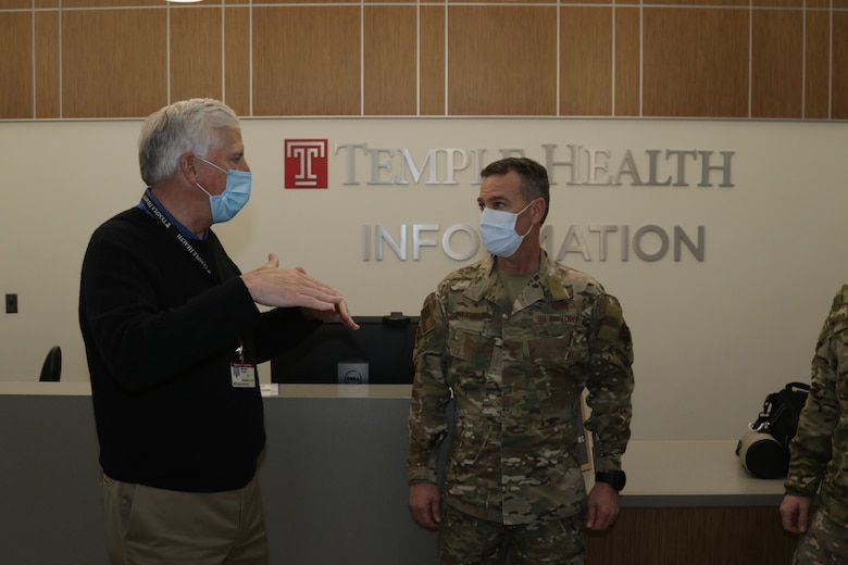 Michael Young, Chief Executive Officer, Temple Health, discusses Temple University Hospital operations with U.S. Air Force Maj. Gen. Chad P. Franks, Task Force-Southeast commander, at Temple University Hospital in Philadelphia, PA, April 27, 2020. Urban Augmentation Medical Task Force 352-1, a U.S. Army Reserve medical task force, is augmenting six Philadelphia area hospitals and the Temple Coronavirus Surge Facility to support Philadelphia COVID-19 relief efforts. U.S. Northern Command, through U.S. Army North, is providing military support to the Federal Emergency Management Agency to help communities in need. (U.S. Army photo by Staff Sgt. Adrian Patoka)