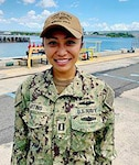 Lt. Melanie Martins, supply officer aboard USS Ohio (SSGN 726), from Angeles City, Philippine, poses for a photo.