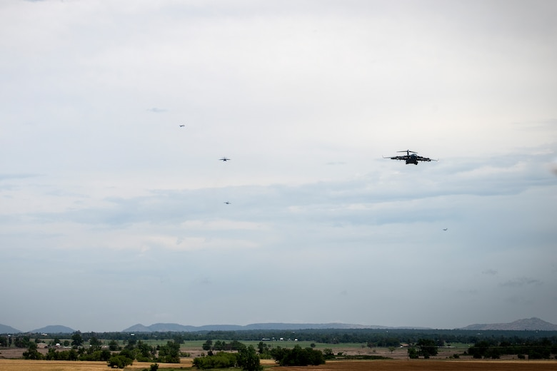 A formation of U.S. Air Force C-17 Globemaster IIIs approach the runway at Altus Air Force Base, Oklahoma, during a large formation exercise, May 21, 2020.