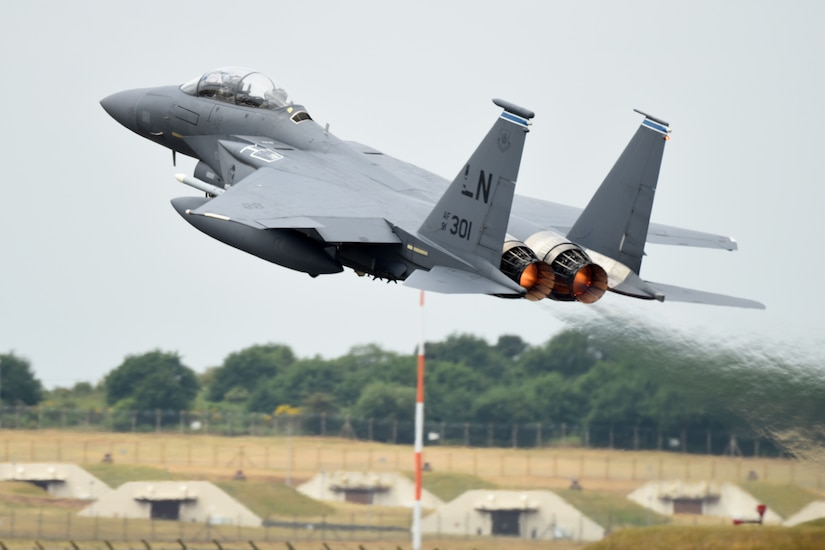 A F-15E Strike Eagle taking off.