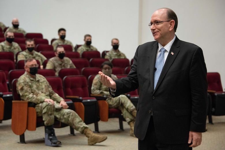 Matthew Donovan, Under Secretary of Defense for Personnel and Readiness, speaks to officer trainees in the Officer Training School auditorium.