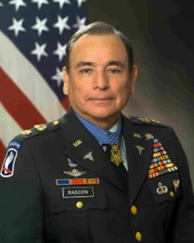A man in a military uniform wears a Medal of Honor.