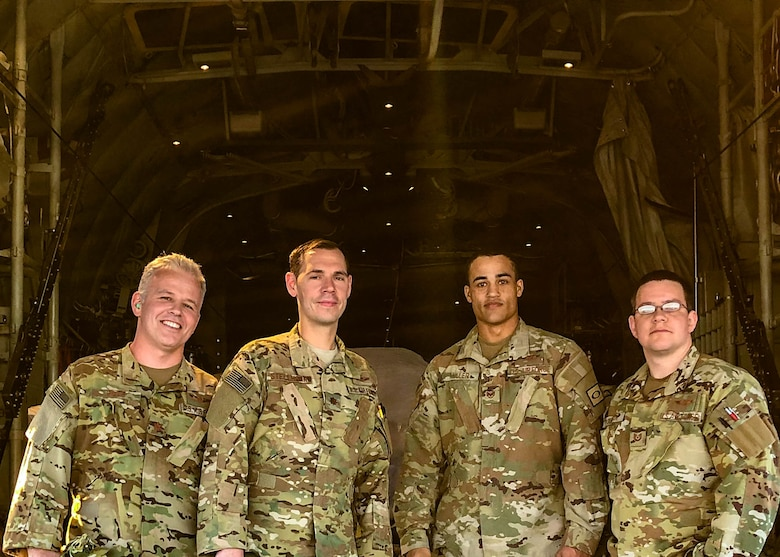 Maj. Andrew Gillis (left), Maj. Ryan Stellhorn (left center), Tech. Sgt. Anthony Miller (right center), and Tech. Sgt. Anthony Miller pose in the cargo area of a C-130J before a mission while assigned to the 746th Expeditionary Airlift Squadron in early 2019. The Air Force Reserve 913th Airlift Group recently was named the recipient of the 2019 General James H. Doolittle Trophy by Air Mobility Command. The award was established by the Air Force Historical Foundation as a way to recognize a unit that has displayed bravery, determination while accomplishing its mission under difficult conditions. (Courtesy photo)