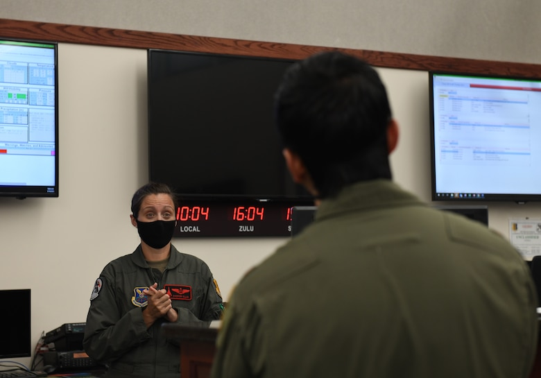 Members of the 34th Bomb Squadron receive a step brief prior to launching from Ellsworth Air Force Base, S.D., May 19, 2020, for a long-range, long-duration Bomber Task Force mission in the U.S. European Command area of responsibility. Flight surgeons help to physically and mentally prepare aviators prior to missions. (U.S. Air Force photo by Airman 1st Class Christina Bennett)