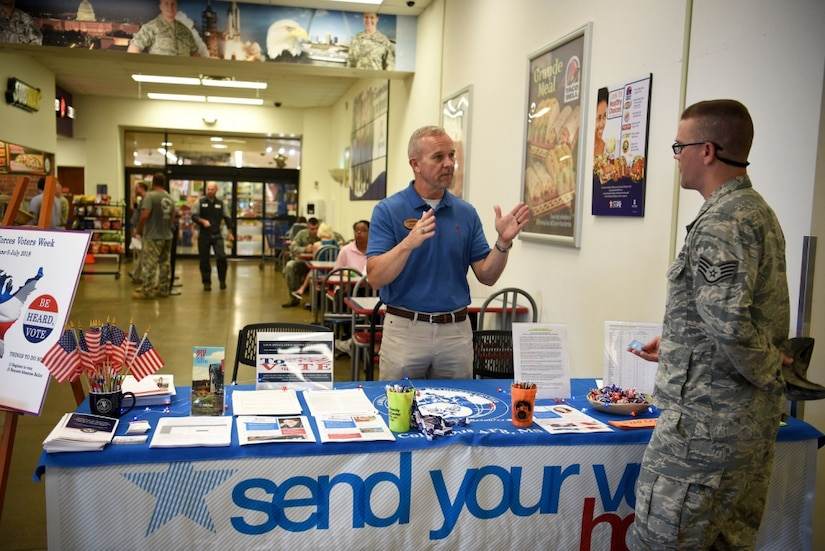 A voting awareness booth is set up at an Air Force base.