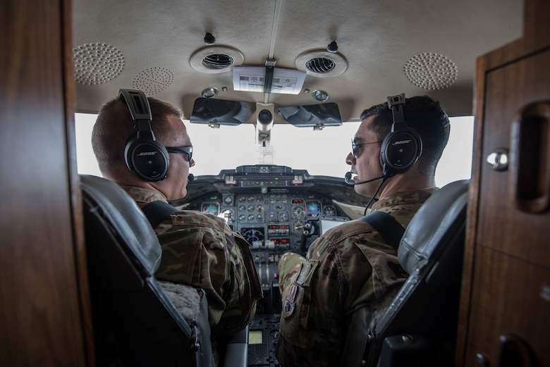 U.S. Air Force 1st Lt. Riley Snowden (left) and Capt. Ramiro Rios, C-21 pilots assigned to the 746th Expeditionary Airlift Squadron, fly a mission over the Middle East, Feb. 7, 2018. (U.S. Air National Guard photo by Master Sgt. Phil Speck)