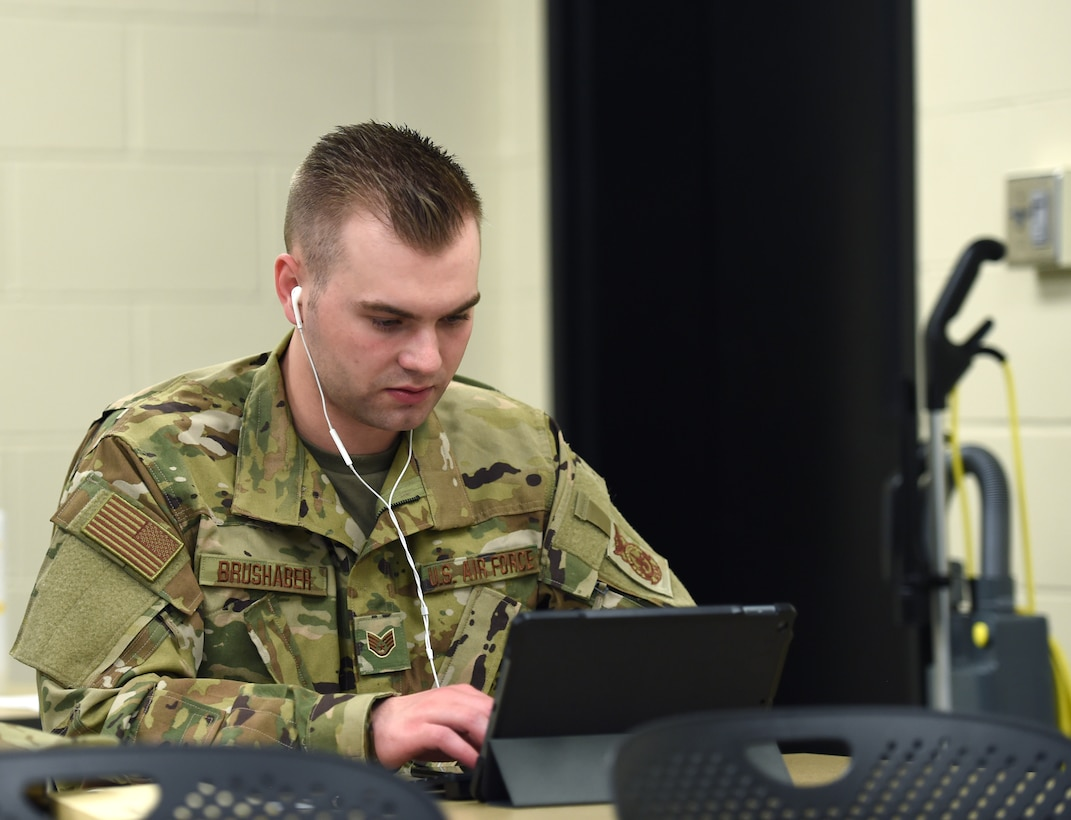 Staff Sgt. Jonathan Brushaber, 132d Wing firefighter, conducts a contact tracing call with a COVID-19 patient May 29, 2020, at the Camp Dodge in Johnston, Iowa. The call center assists the Iowa Department of Public Health with contact tracing. (U.S. Air National Guard photo by Staff Sgt. Michael J. Kelly)