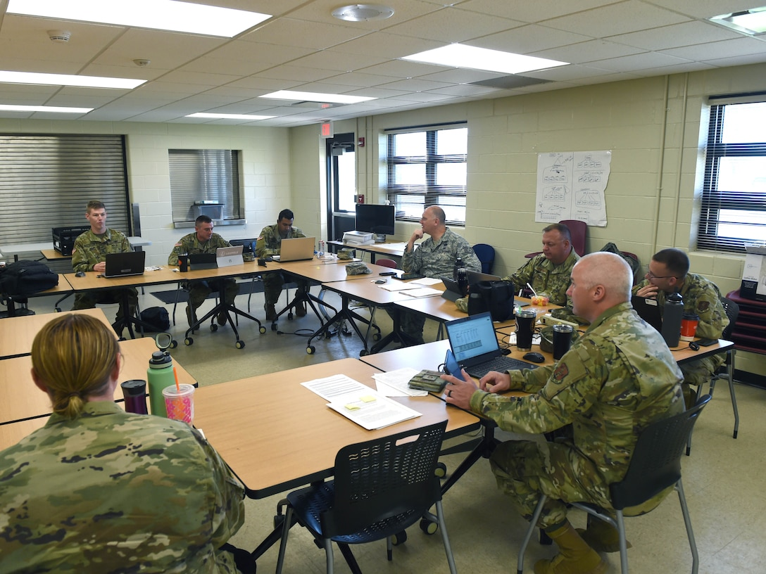 132d Wing Airmen along with Iowa Army National Guard Soldiers operate a COVID-19 contact tracing call center May 29, 2020, at Camp Dodge in Johnston, Iowa. The Airmen and Soldiers assist the Iowa Department of Public Heath in contact tracing. (U.S. Air National Guard photo by Staff Sgt. Michael J. Kelly)
