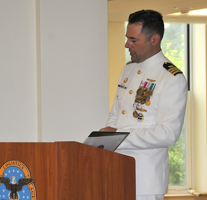 Cmdr. Klemm speaks to his team at his retirement ceremony