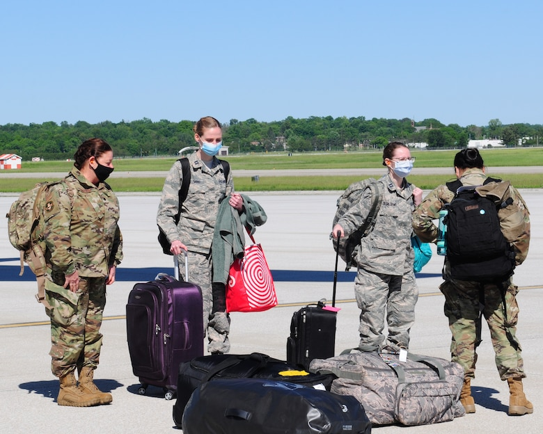 Airmen from the 445th Aeromedical Staging Squadron return home here May 31, 2020, after arriving on a 445th Airlift Wing C-17 Globemaster III. The medical reservists departed to serve on the front line of COVID-19 in New York City, New York in early April, 2020. The group partnered with civilian and military counterparts to support the Lincoln Medical Center in The Bronx, New York during the pandemic. (U.S. Air Force photo/Airman 1st Class Erin Zimpfer)