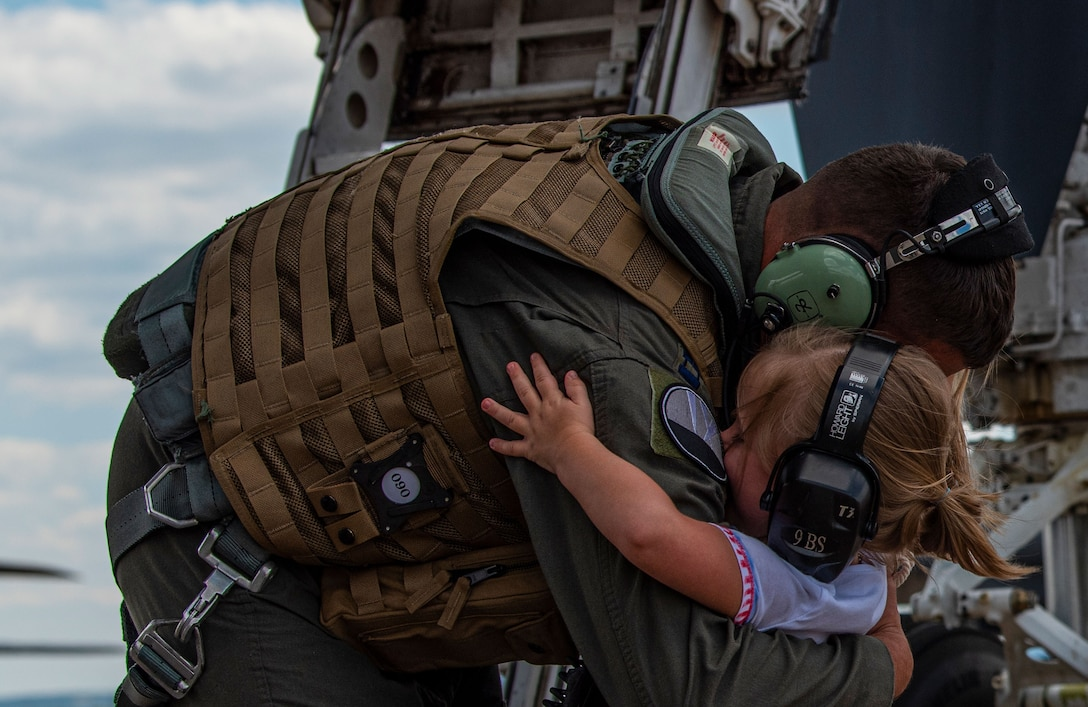 Capt. Robert Flemming embraces his daughter after deployment.