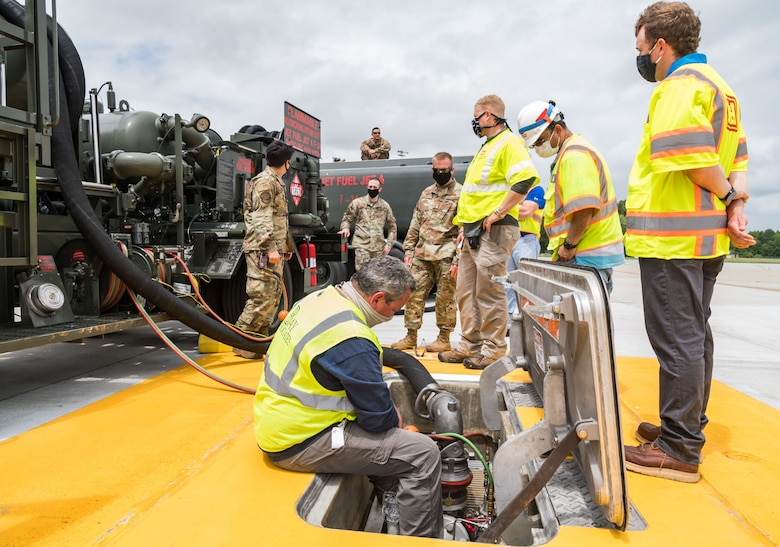 Personnel from the U.S. Army Corps of Engineers, Omaha and Philadelphia Districts; Bay Associates, Virginia Beach, Virginia; Structural Associates Inc.,  Syracuse, New York and 436th Civil Engineer Squadron monitor fuel flow and pressures during operational testing of the new fuel hydrant system located at the aircraft hot cargo area May 28, 2020, on Dover Air Force Base, Delaware. During fuel hydrant system testing, the R-12 pumped Jet-A fuel from the fuel pit to an R-11 fuel truck, which was used to simulate a receiver aircraft. (U.S. Air Force photo by Roland Balik)