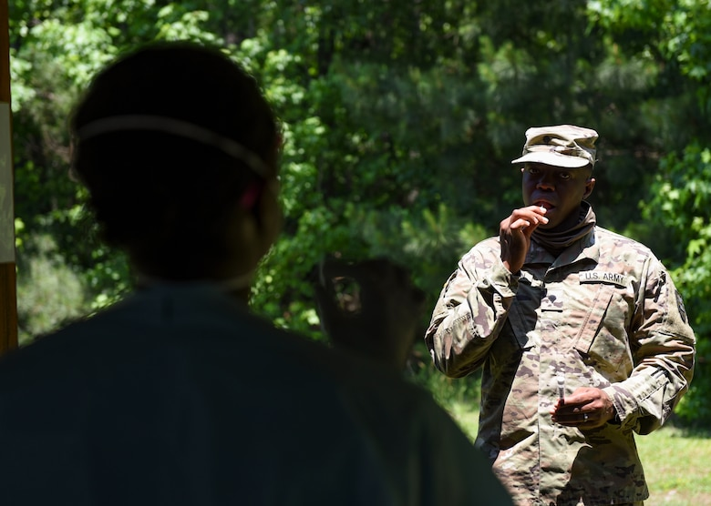 McDonald Army Health Center staff members conduct oral swab tests during a mass rapid COVID-19 testing at Joint Base Langley-Eustis, Virginia, June 3, 2020. The MCAHC members guided U.S. Army Soldiers through swab procedures while maintaining distance to ensure safe practices. (U.S. Air Force photo by Senior Airman Monica Roybal)