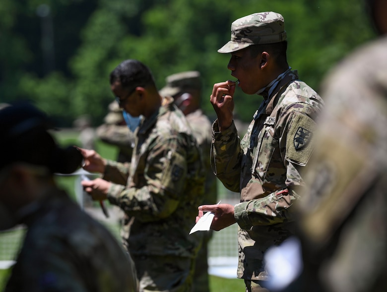 U.S. Army Soldiers participate in mass rapid COVID-19 testing with a mass rapid COVID-19 test at Joint Base Langley-Eustis, Virginia, June 3, 2020. The Department of Defense chose JBLE as the first military installation to conduct testing of approximately 7,800 service members over a three-day period. (U.S. Air Force photo by Senior Airman Monica Roybal)
