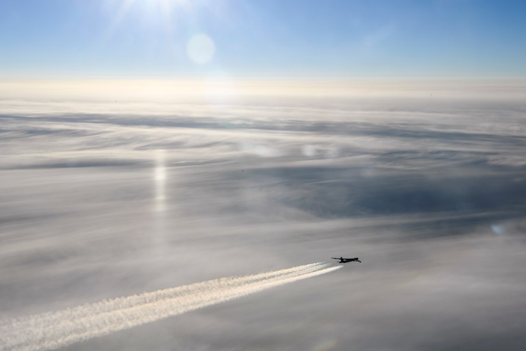 An aircraft flies over the arctic.