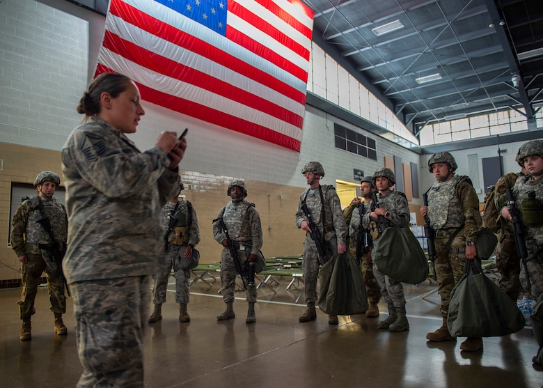 U.S. Air Force Airmen from the 133rd Airlift Wing check in at the Cedar Street armory to perform augmentee security detail in St. Paul, Minn., June 1, 2020.