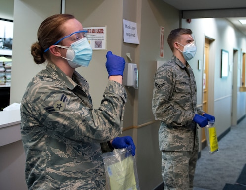 U.S. Air Force Airmen from the 133rd Medical Group, provide instructions on how to administer the COVID-19 test in St. Paul, Minn., June 4, 2020.