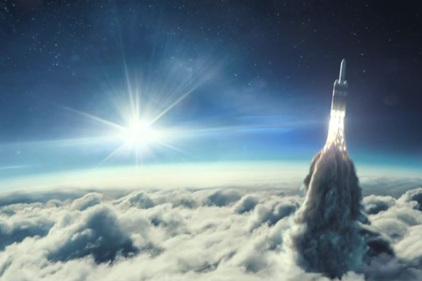 A rocket breaks through clouds.