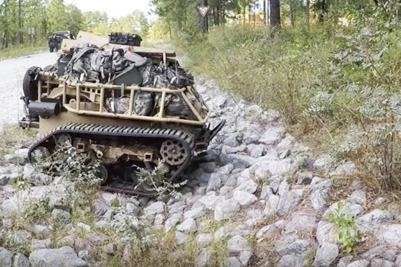 A robotic vehicle moves over rocks.