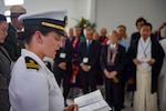 Lt. Emily Rosenzweig, a chaplain assigned to 3rd Radio Battalion Religious Ministry Team at Marine Corps Base Hawaii, reads a Hebrew prayer aboard the USS Arizona Memorial during an Interfaith Prayer service and Floral Tribute. The event allowed religious leaders from the U.S. military, Hawaii, and Japan to engage in prayer to honor the fallen service members. Dec. 7, 2016, marks the 75th anniversary of the attacks on Pearl Harbor and Oahu. Since Dec. 7, 1941, the U.S. and Japan have endured more than 70 years of continued peace, a cornerstone of security and prosperity in the Indo-Asia-Pacific region. As a Pacific nation, the U.S. is committed to continue its responsibility of protecting the Pacific sea-lanes, advancing international ideals and relationships, well as delivering security, influence and responsiveness in the region.