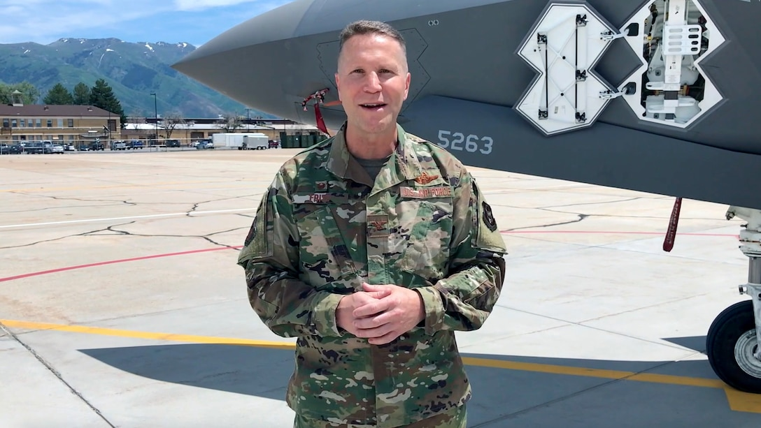 """Due to COVID-19 restrictions on mass gatherings, the new 419th Fighter Wing commander, Col. Matthew """"Eddie"""" Fritz, addresses wing personnel via video from the Hill Air Force Base flightline"""
