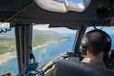 Lt. Col. Chris Skoutas, 535th Airlift Squadron pilot flies a C-17 Globemaster III off the coast of Kauai Island, Hawaii May 14, 2020.