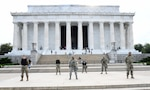 Airmen from the 113th Wing, D.C. Air National Guard, stand on the national mall