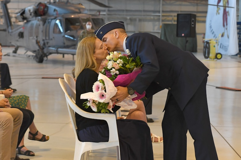 U.S. Air Force Brig. Gen. Daniel T. Lasica, 31st Fighter Wing outgoing commander, presents his family with flowers and gifts during a change of command ceremony at Aviano Air Base, Italy, June 5, 2020. U.S. Air Force Brig. Gen. Daniel T. Lasica led 4,500 airmen supporting operations across three combatant commands from June 17, 2018 to June 5, 2020. (U.S. Air Force photo by Staff Sgt. Valerie Halbert)