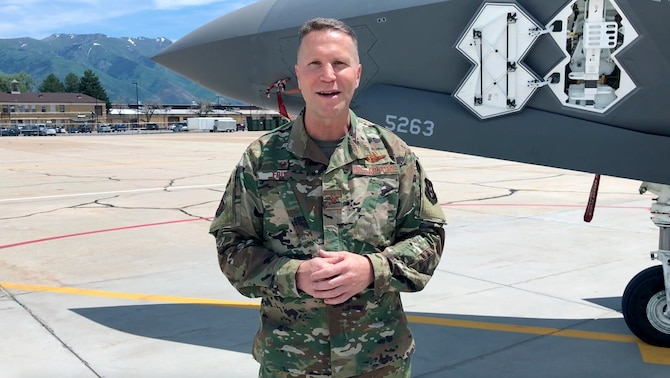 "Due to COVID-19 restrictions on mass gatherings, the new 419th Fighter Wing commander, Col. Matthew ""Eddie"" Fritz, addresses wing personnel via video from the Hill Air Force Base flightline"