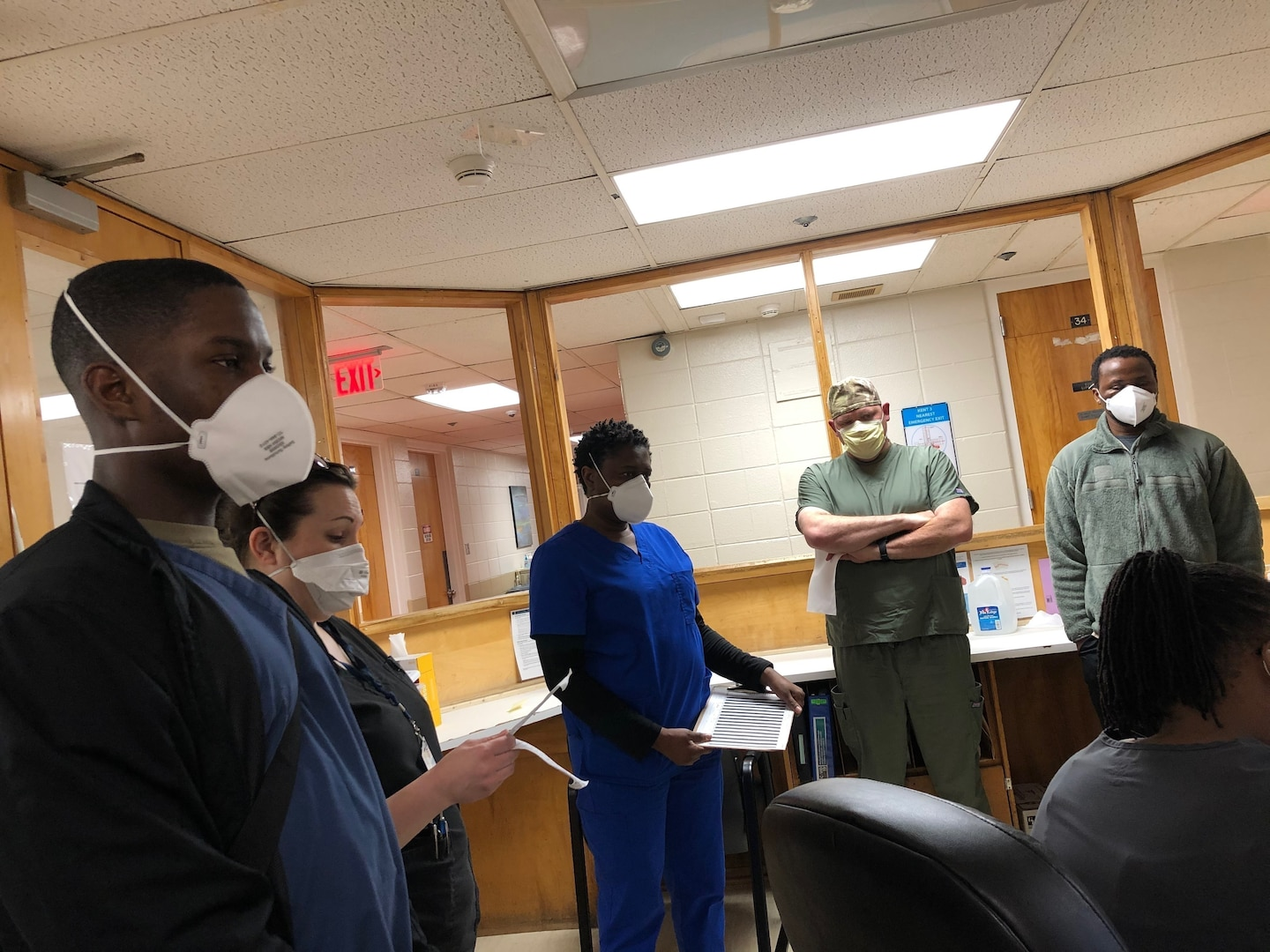 Soldiers and Airmen with the Delaware National Guard wear personal protective equipment at the Delaware Psychiatric Center in New Castle, Delaware, May 4, 2020.