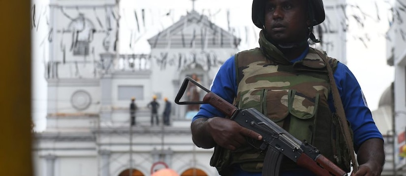 A Sri Lankan security officer stands guard in the aftermath of the 2019 Easter attacks