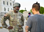 Minnesota National Guard Master Sgt. Acie Matthews Jr. peacefully engages with protesters to show solidarity and request compliance with the state curfew at the grounds of the Minnesota state capitol in St. Paul, June 1, 2020.