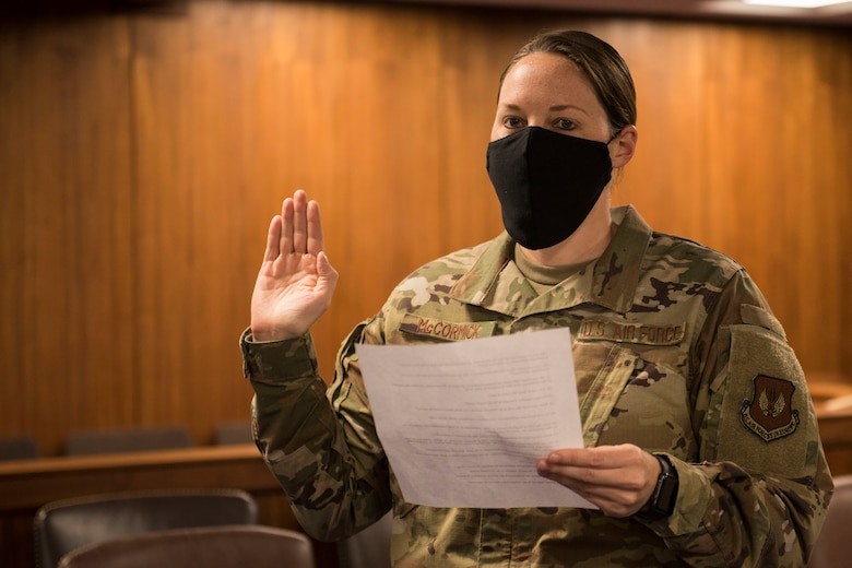 U.S. Air Force Capt. Lauren McCormick, 501st CSW Judge Advocate Office chief of operations and civil law, leads an oath during a will execution ceremony June 2, 2020, at RAF Alconbury, England. The 501st Combat Support Wing legal office hosted a deployment brief and will execution ceremony for all Security Forces deploying in the next 60 days. (U.S. Air Force photo by Airman 1st Class Jennifer Zima)