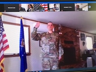 Joseph Dolce, program manager for Cloud One at Hanscom Air Force Base, Mass., is promoted to the rank of lieutenant colonel during a virtual ceremony March 27. On March 31, Dolce read the oath of office for his twin brother Paul, who was promoted to lieutenant colonel March 31. Lt. Col. Paul Dolce currently serves as the commander of the 586 Flight Test Squadron at White Sands Missile Range, N.M.